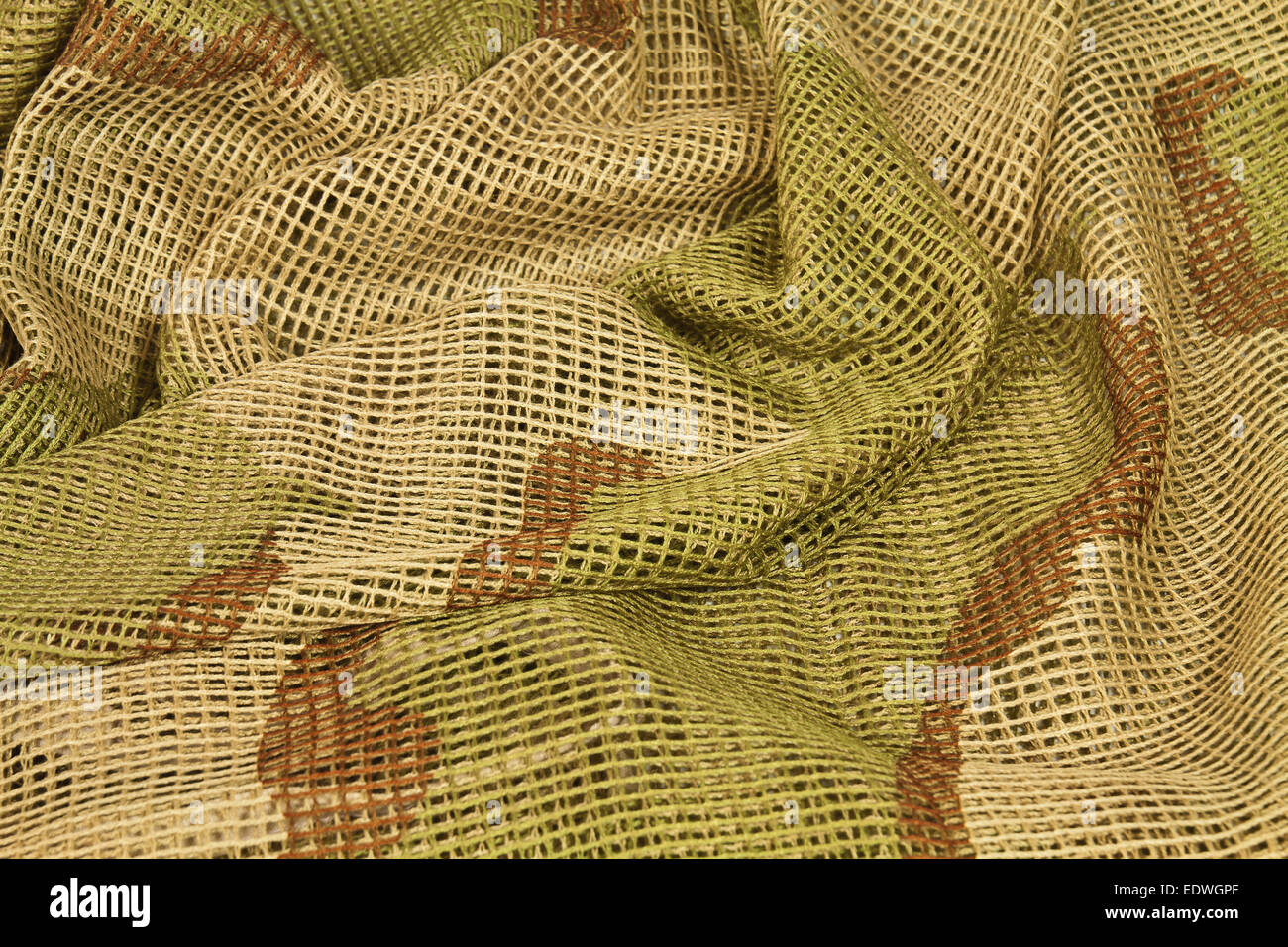 Cotton camouflage netting designed to wrap around the head
