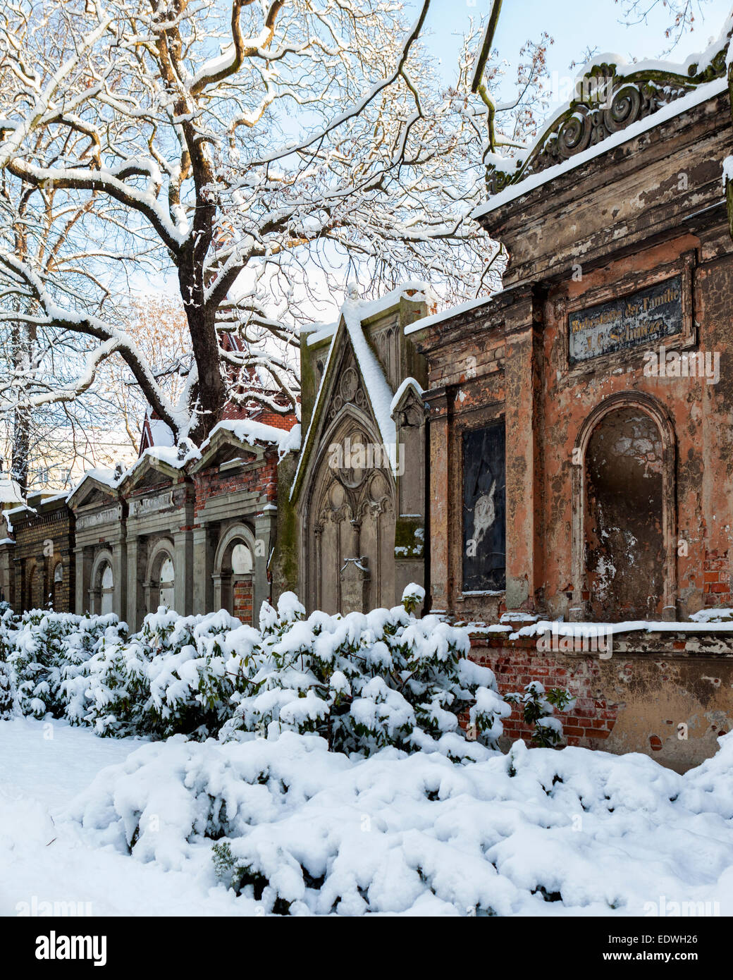 Sophien Parish cemetery - decorative memorials and tombs & snow covered trees in Winter, Friedhof der Sophien - Stock Image