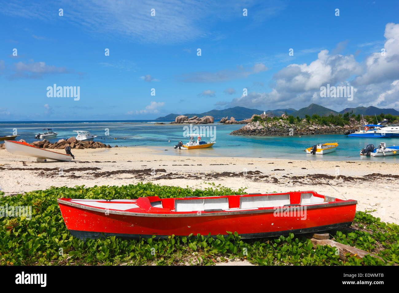 Red boat on the sand beach. Island  La Digue, Seychelles. Stock Photo