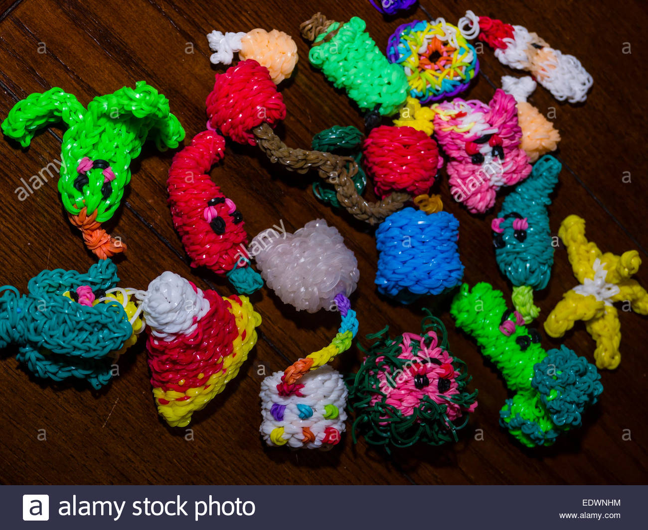 loom bands creations by nine year old Fun Figures - Stock Image