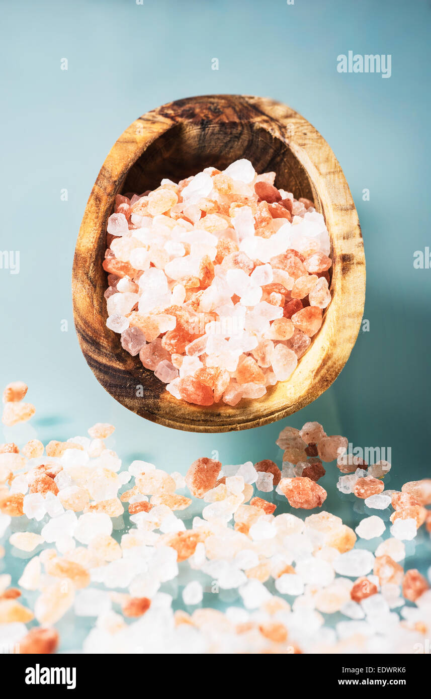 Pink salt from himalaya in a olive wooden spoon - Stock Image