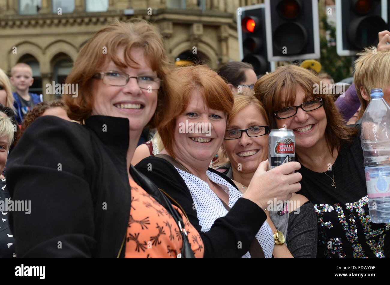 Onlookers at the Manchester Gay Pride Parade. - Stock Image