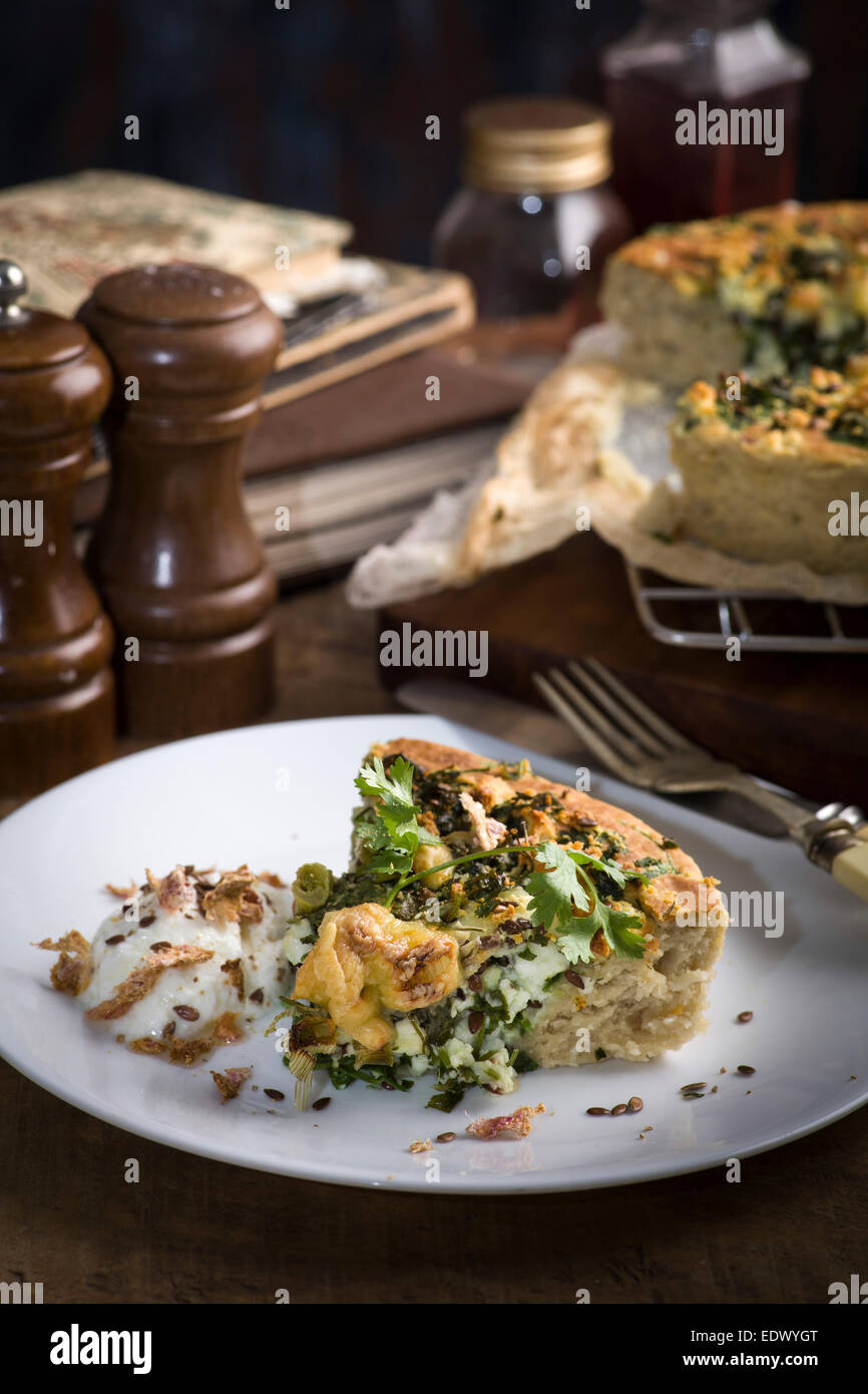 The recipe of potato and cheese pie with herbs and sour creme - Stock Image