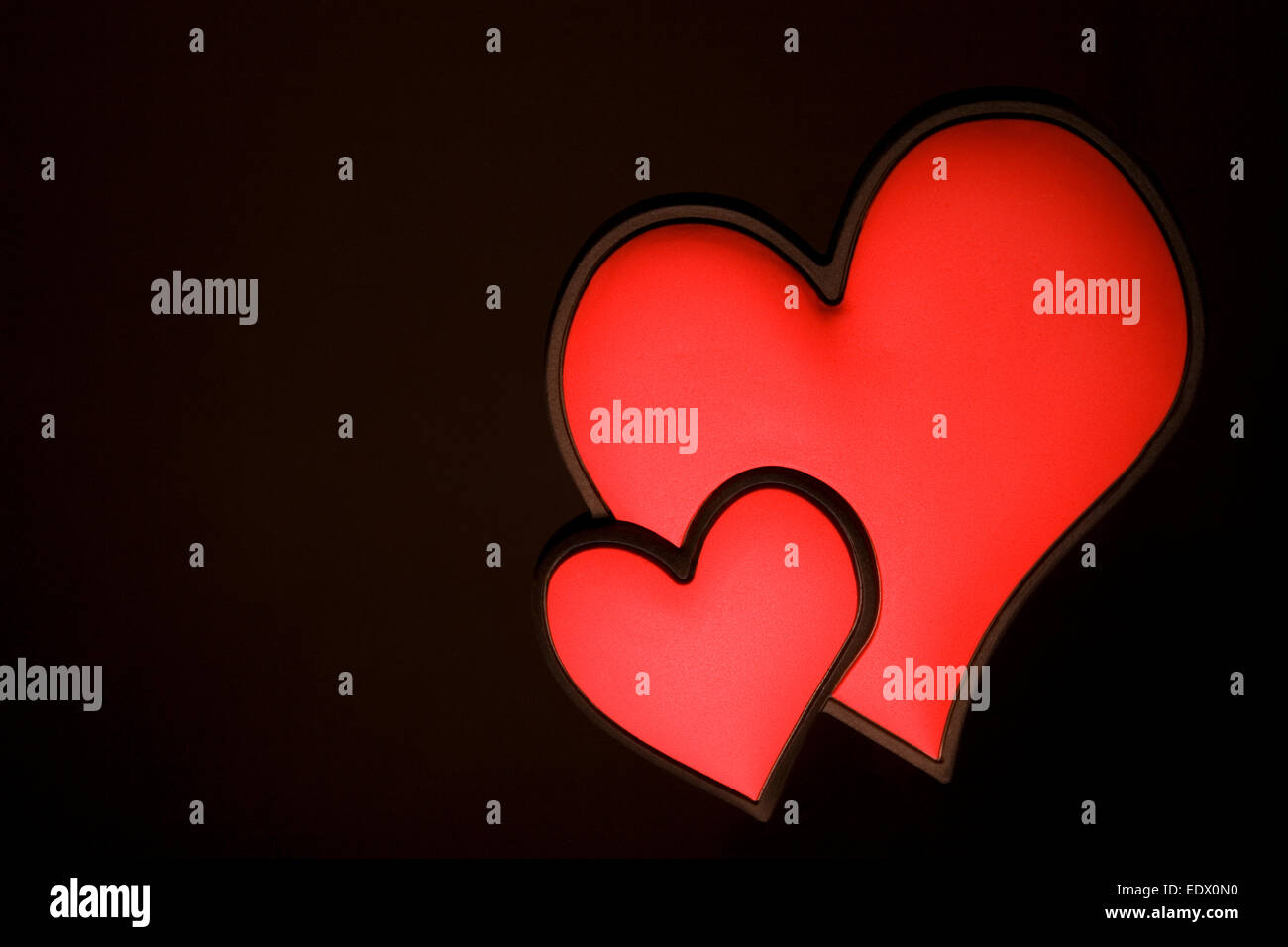 Two Red Love Hearts Joined Together With A Black And Flower Wallpaper Background