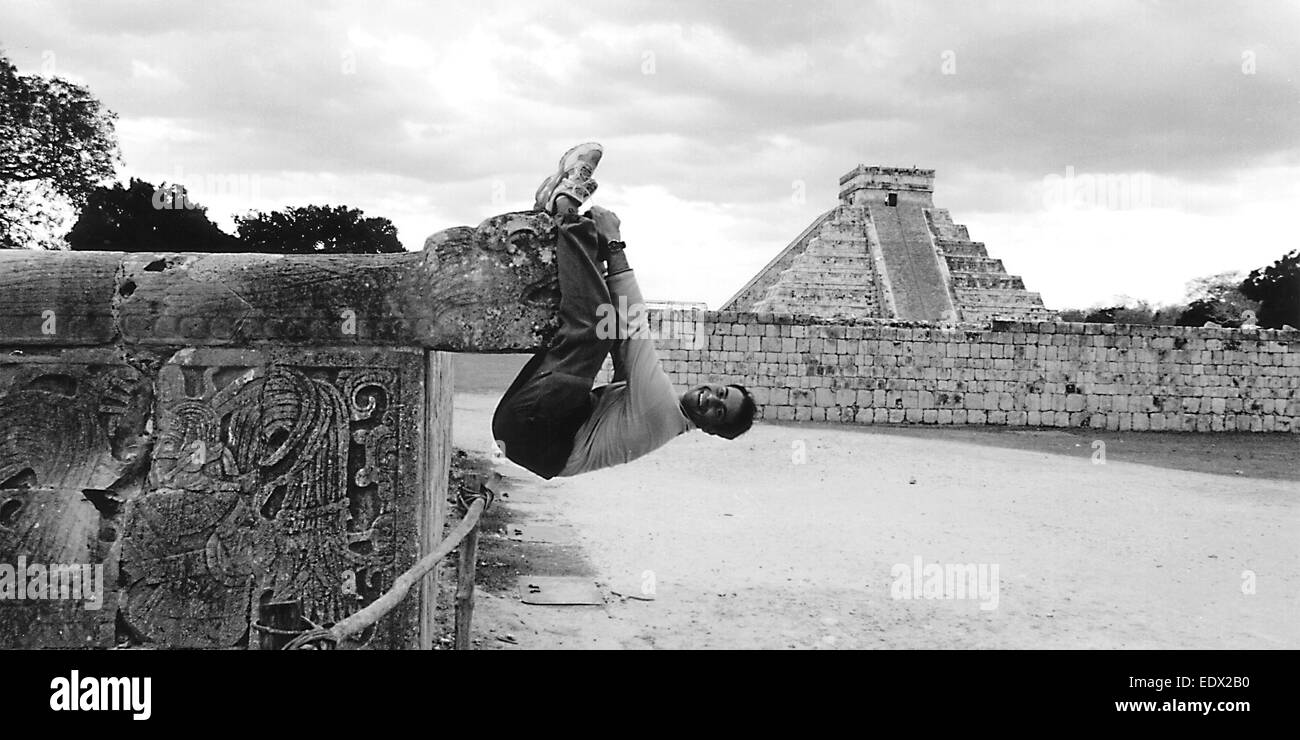 Man climbs on the dragon of  Chichen Itza, forbidden sacrilege, affront, insult - Stock Image