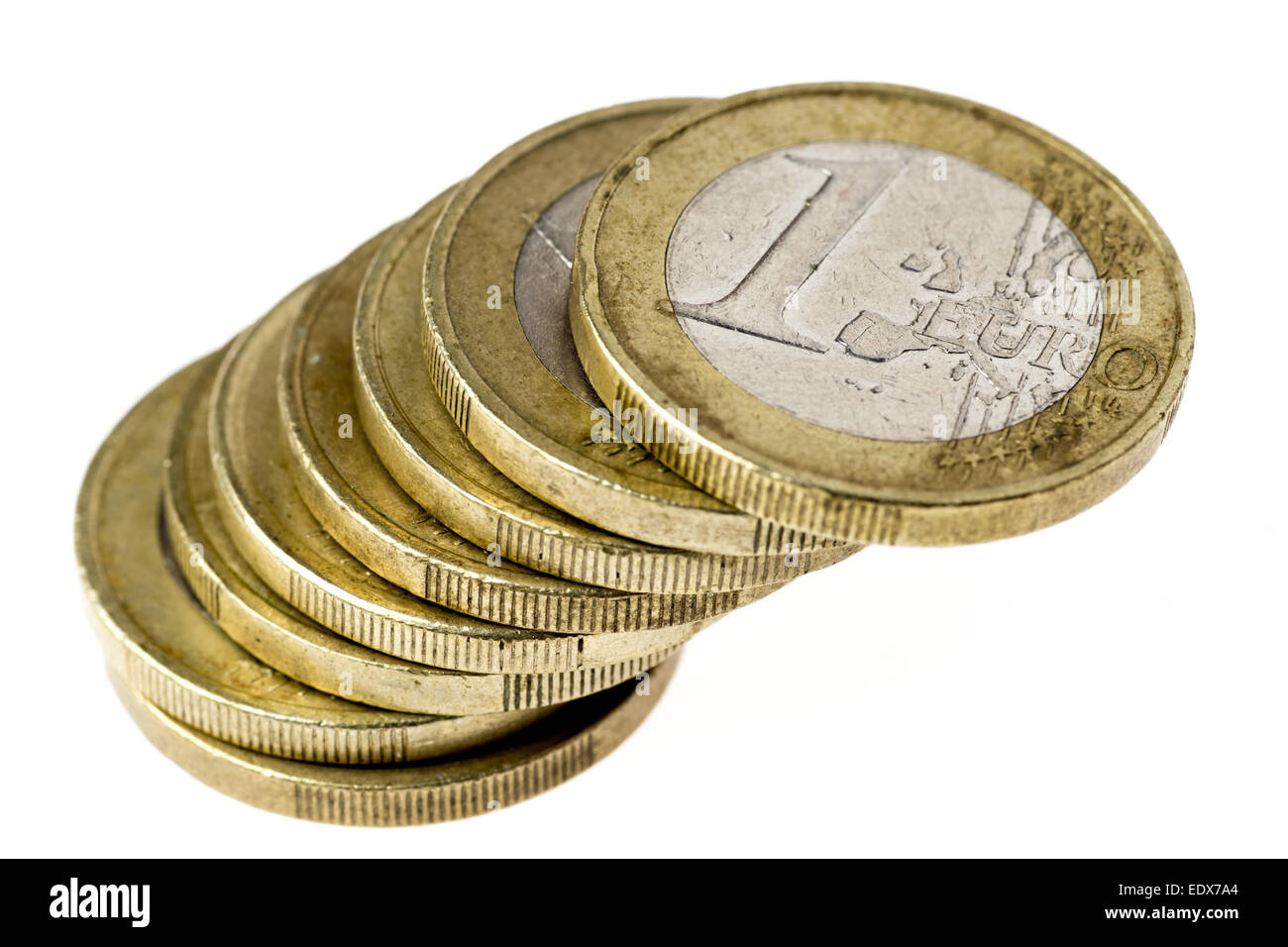 Pile of one Euro coins precariously balanced and about to collapse - Stock Image