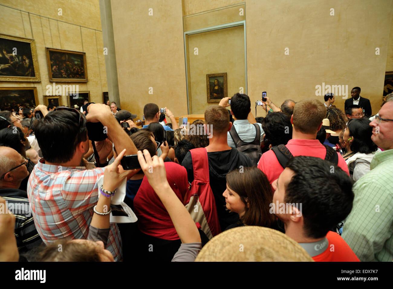 paris, the louvre museum, crowd of tourists around the gioconda - Stock Image