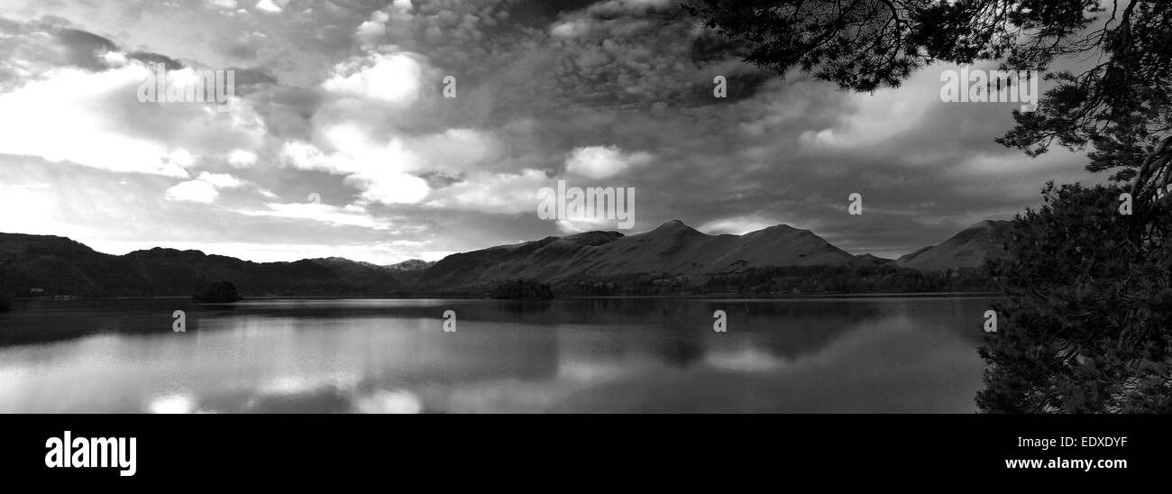 Dawn Sunrise over Cat Bells Fells reflected in Derwentwater lake near the town of Keswick, Lake District National - Stock Image