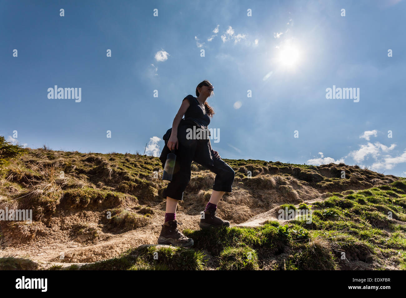 Woman hiking in the Bavarian Alps in Germany. - Stock Image