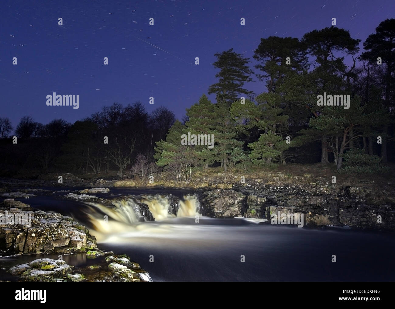 Night Sky with Meteorite at Low Force on the River Tees, Bowlees Teesdale County Durham UK - Stock Image
