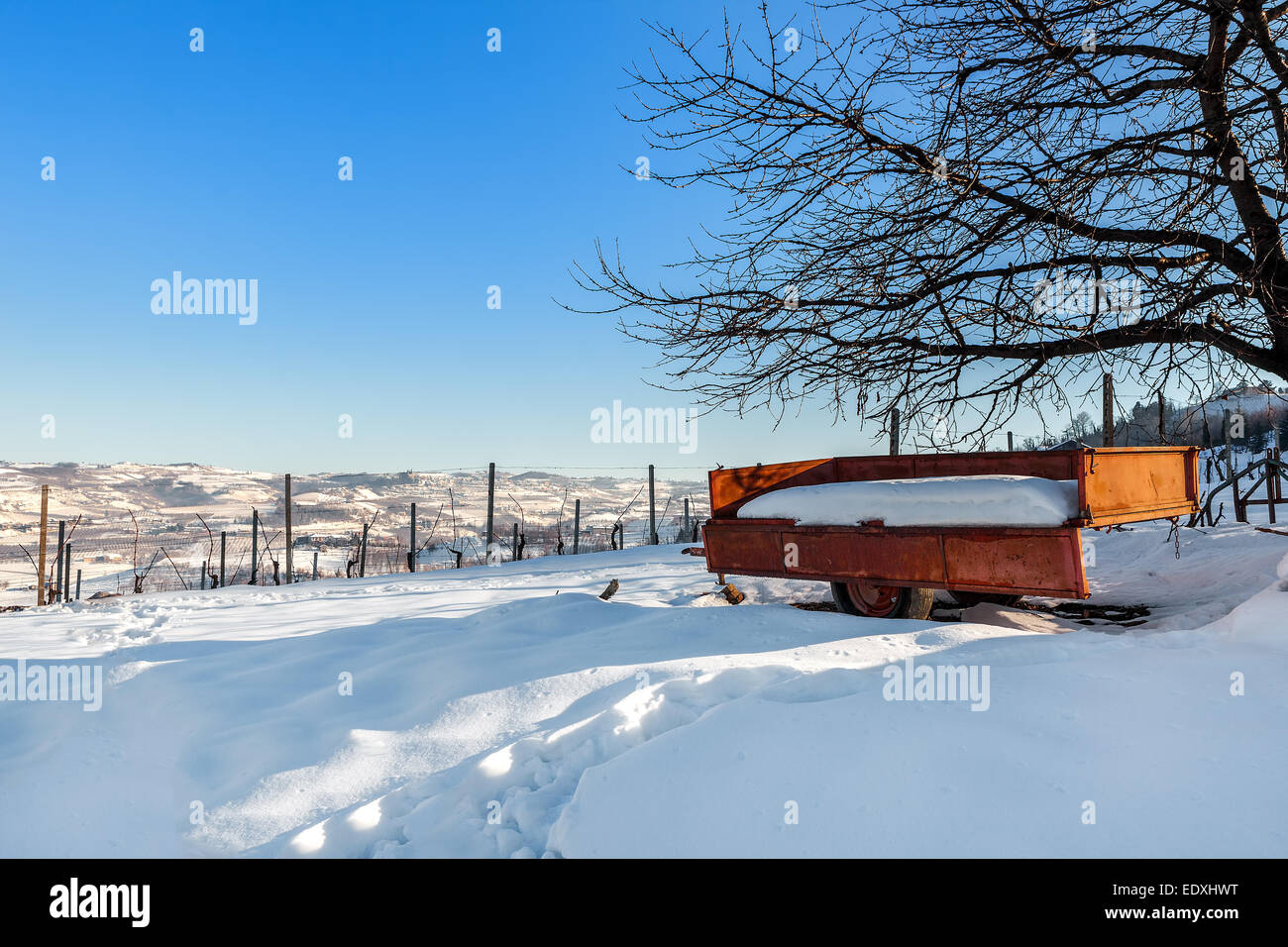 Rural cart on the field covered with snow in Piedmont, Northern Italy. - Stock Image