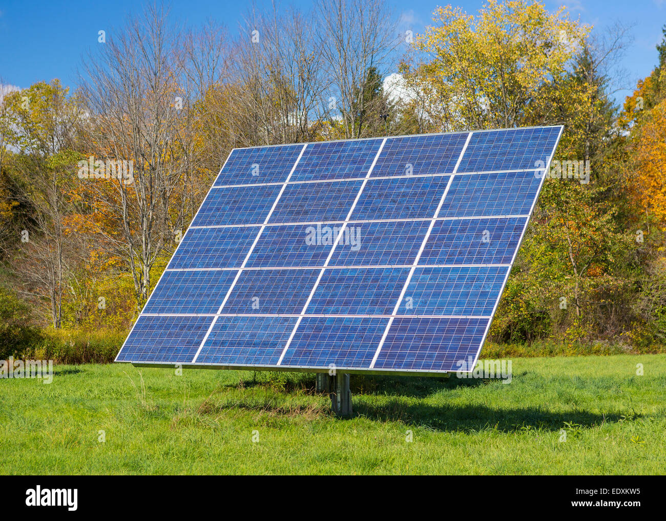 IRASVILLE, VERMONT, USA - Solar power panel in field, Mad River Valley. Alternative energy. - Stock Image