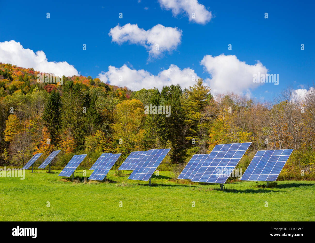 IRASVILLE, VERMONT, USA - Solar power panels in field, Mad River Valley. Alternative energy. - Stock Image