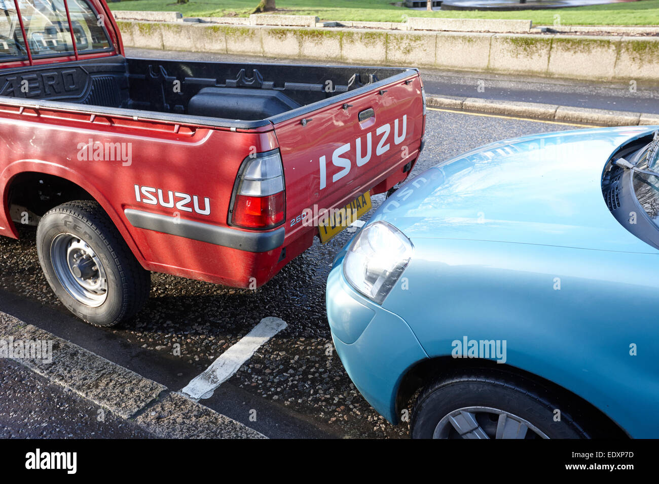 car parked outside designated parking box on street parking in the uk - Stock Image