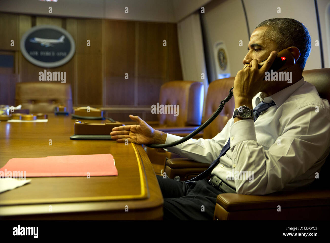 President Barack Obama talks on the phone with French President Francois Hollande from aboard Air Force One, Jan. Stock Photo