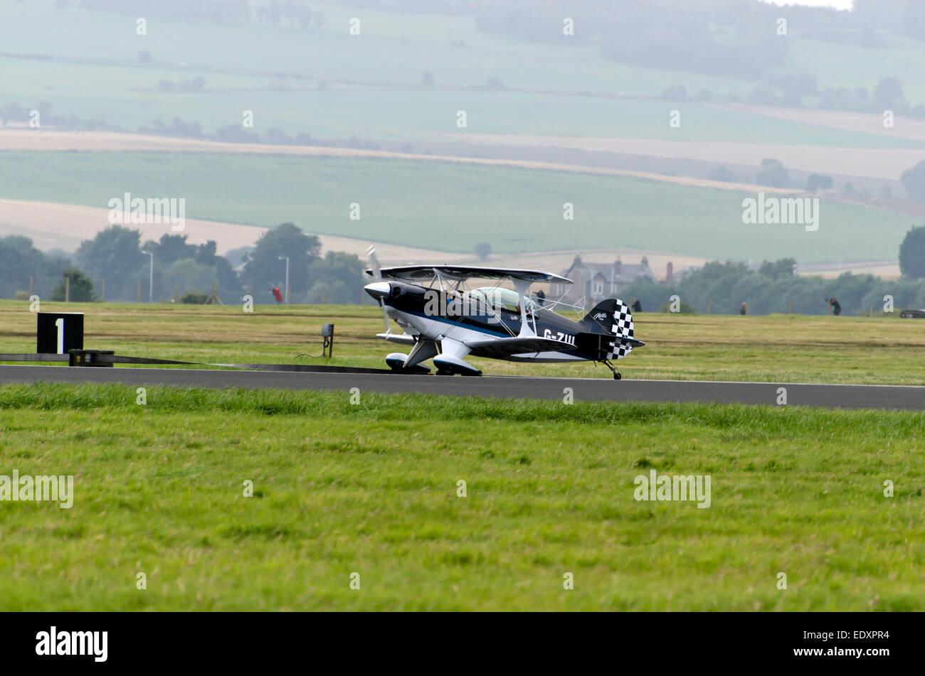 Member of the Wildcat Acrobats display team landing a Pitts S-2 bi-plane at Leuchars Air Show, Scotland, 2013. - Stock Image