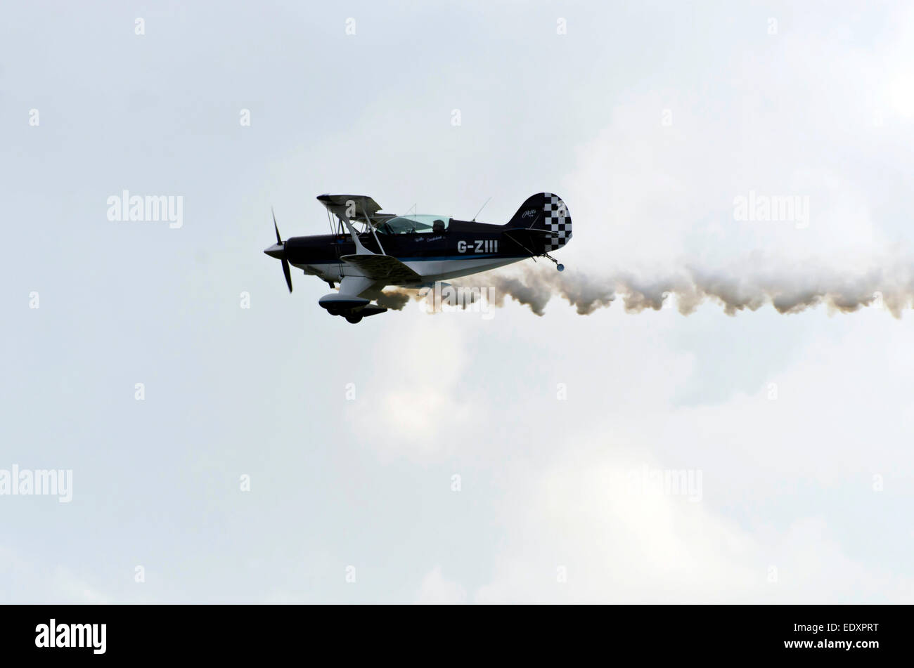 Member of the Wildcat Acrobats display team flying a Pitts S-2 bi-plane at Leuchars Air Show, Scotland, 2013. - Stock Image