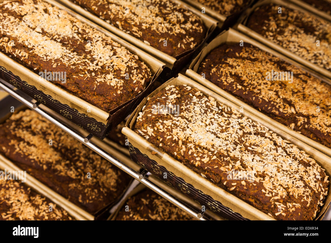 Gluten-free and vegan coconut-banana dessert loaves fresh out of the oven - Stock Image