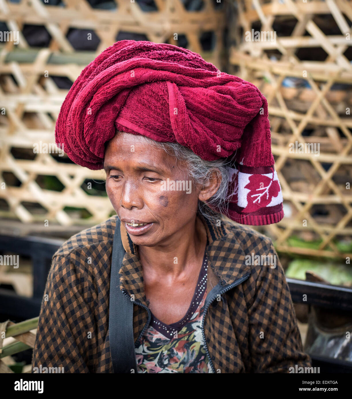 Elderly woman wearing a head scarf, Ubud district, Bali, Indonesia - Stock Image