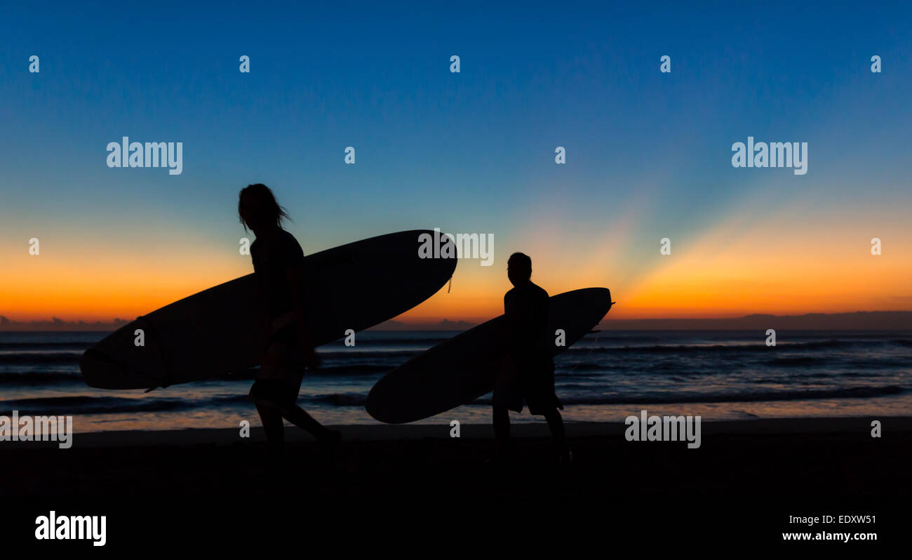Surfers at sunset, Sanur Beach, Bali, Indonesia, Asia - Stock Image