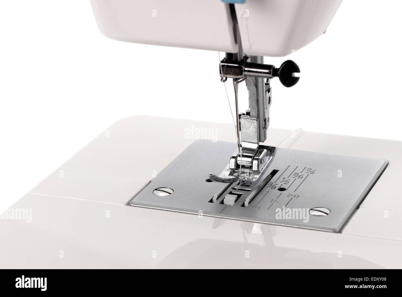 The image of the electrical sewing machine on a white background. - Stock Image