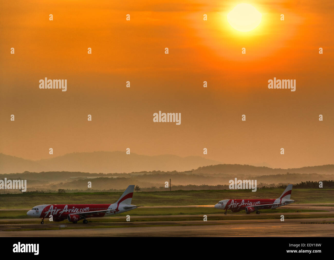 Air Asia planes airplanes aircraft rolling on taxiway waiting for take-off at Kuala Lumpur International Airport - Stock Image