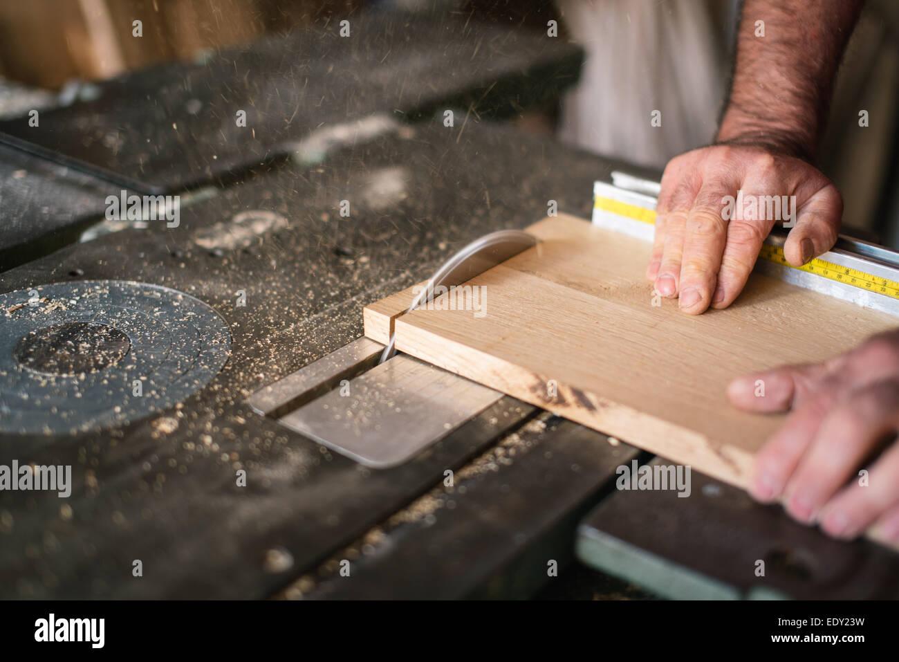 Carpenter working on the circular saw - Stock Image