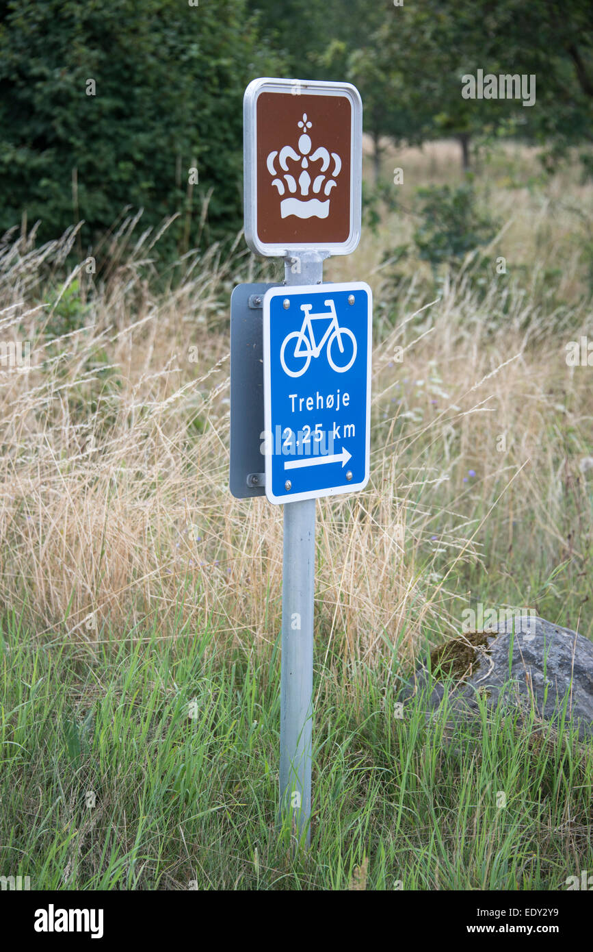 A cycle sign and the Danish Royal Crown sign on the cycle way in the Mols Bjerge National Park in East Jutland, - Stock Image