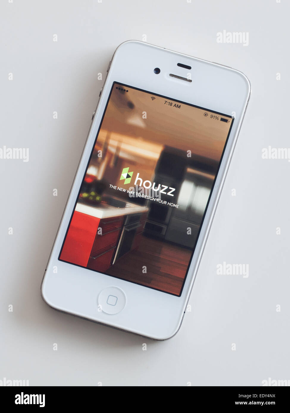 The Homescreen And Logo Of The Houzz Mobile App On A White Apple IPhone 4.