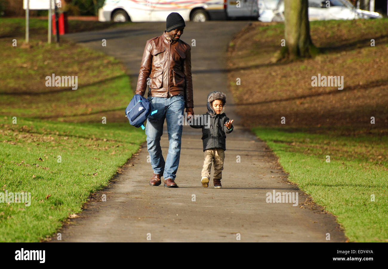 Afro-Caribbean man with a child - Stock Image