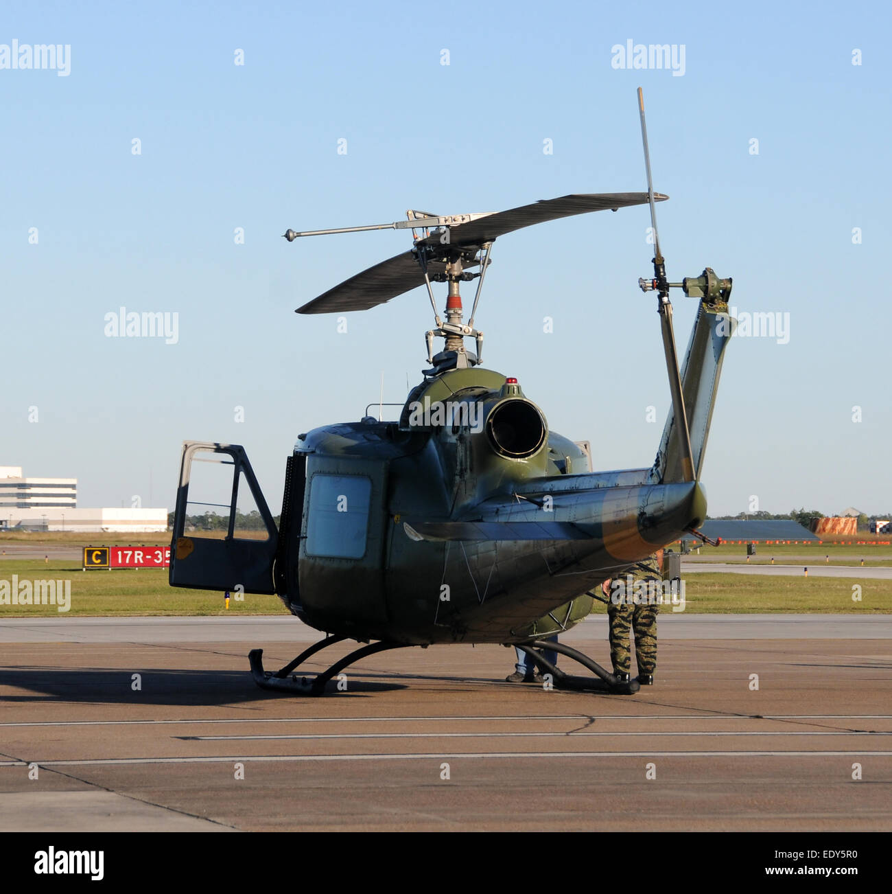 Vietnam War era helicopter on the ground rear view UH-1 Huey
