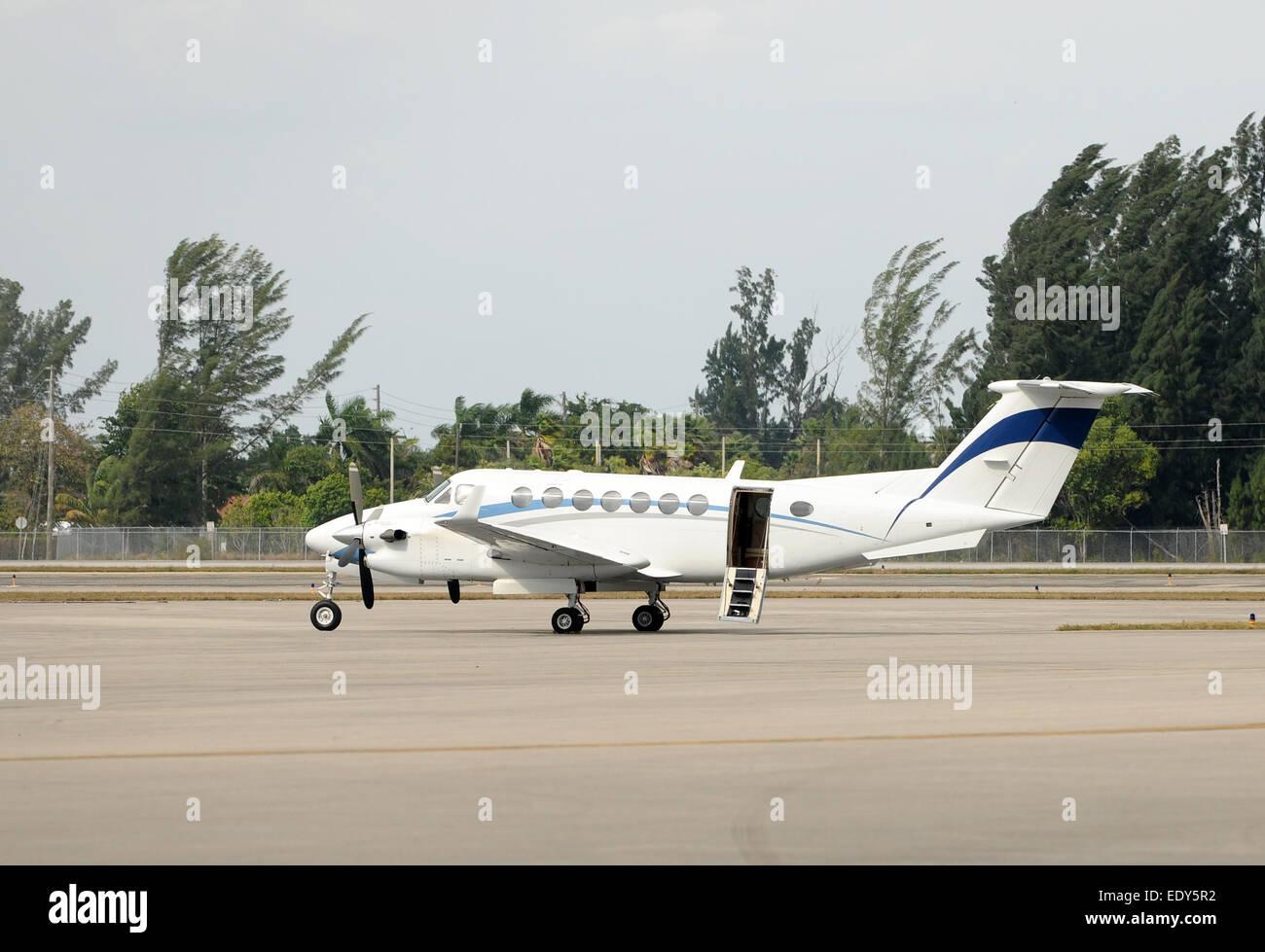Turboprop airplane for regional travel awaiting passengers - Stock Image