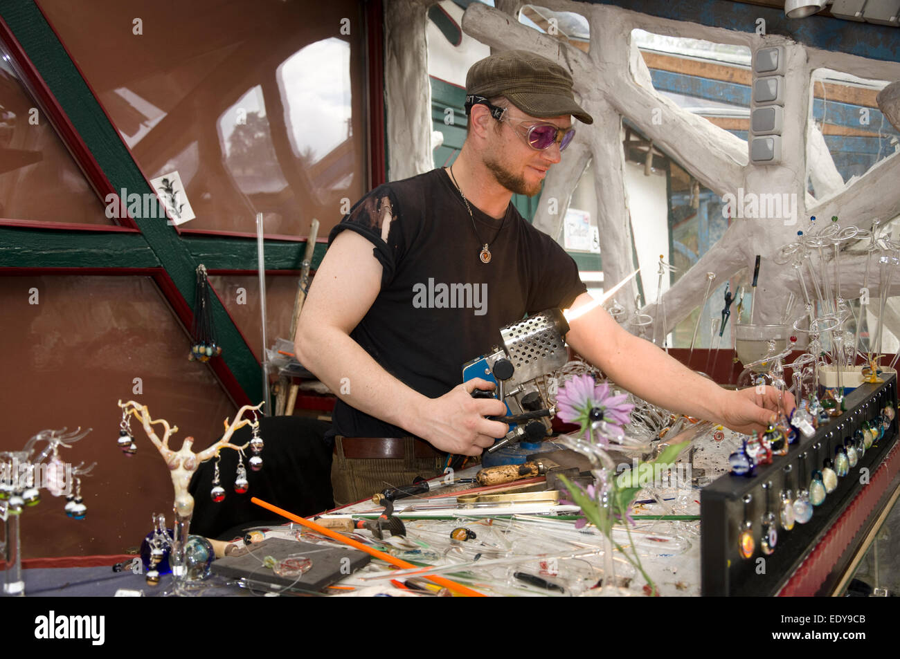 Glass blower working inside of the Isarhatsche - Estate - the 'heath castle' in Northern Germany - Stock Image