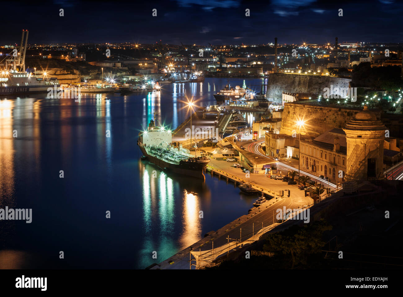 Grand Harbour and Waterfront of Valletta at night, Malta - Stock Image