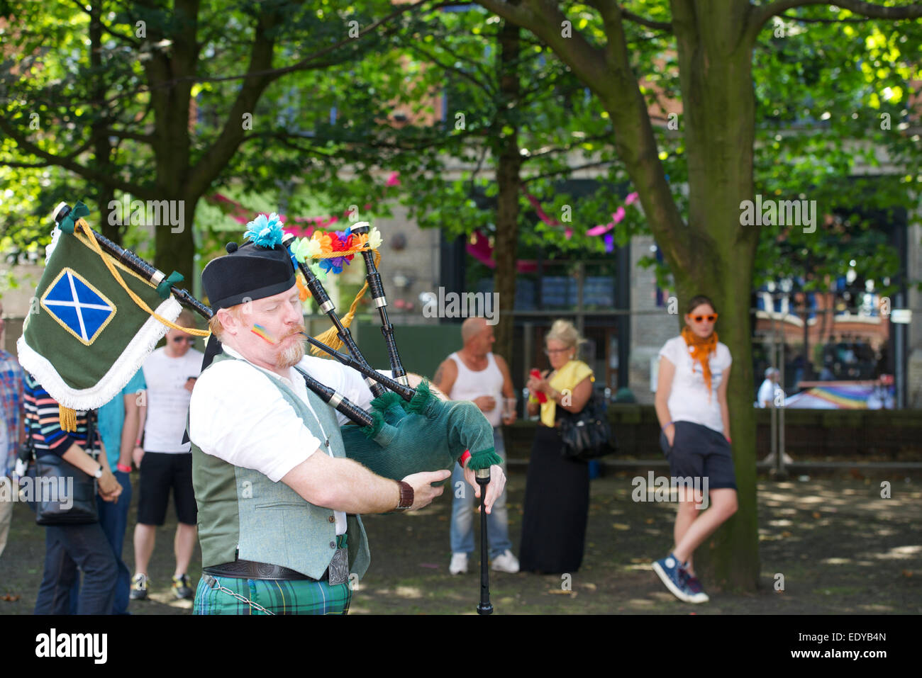 Piper plays in Sackville Gardens during the Manchester Gay Pride. - Stock Image