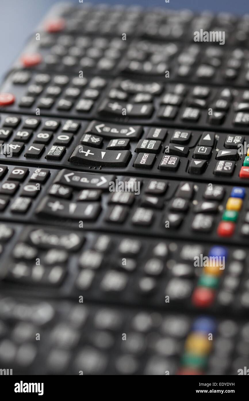tv remote controls in a row - Stock Image