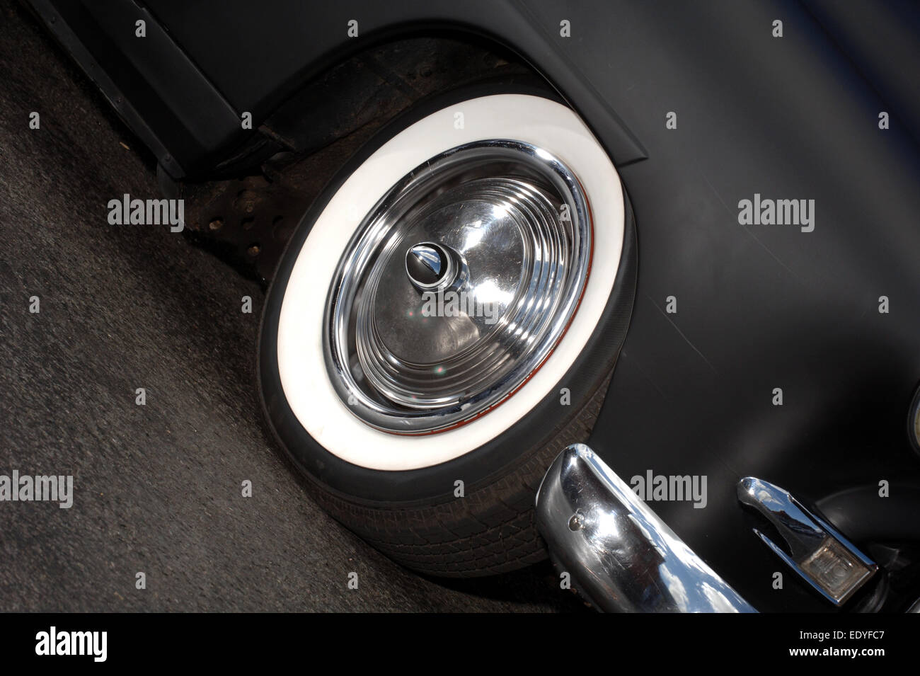 Chrome hubcap on a hot road car, ripple disk with smoothie centre and bullet cap - Stock Image