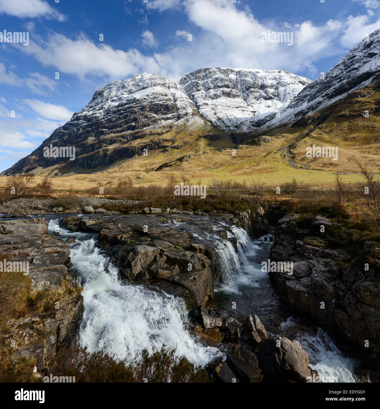 The river Coe with the cliffs of the Aonach Dubh buttress in the background - Stock Image