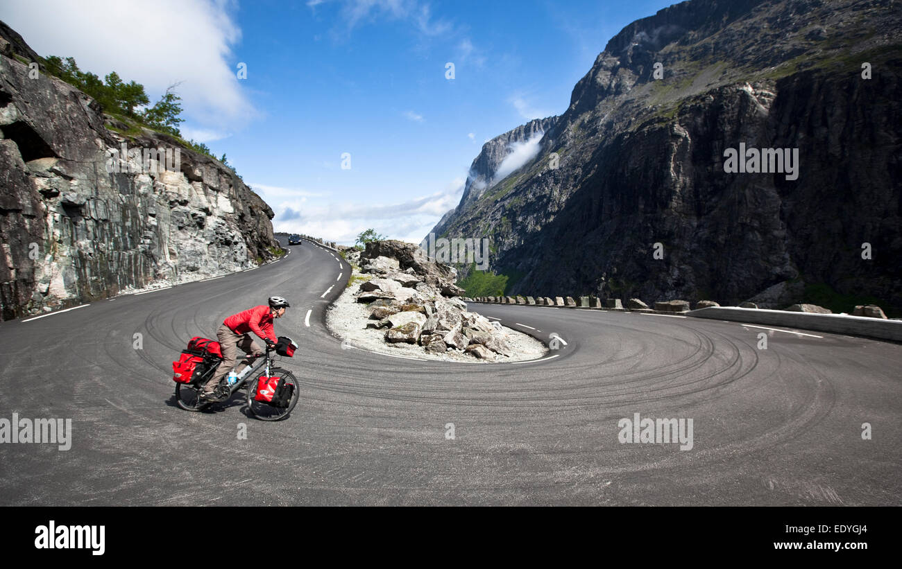 Cycle tour, cyclist on the Trollstigen serpentine mountain road, Trollstigen Pass Road, Trolls' Path, near Andalsnes - Stock Image