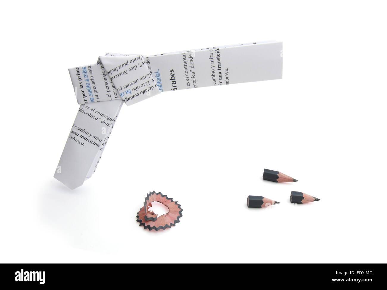 origami gun and pencil bullets - Stock Image