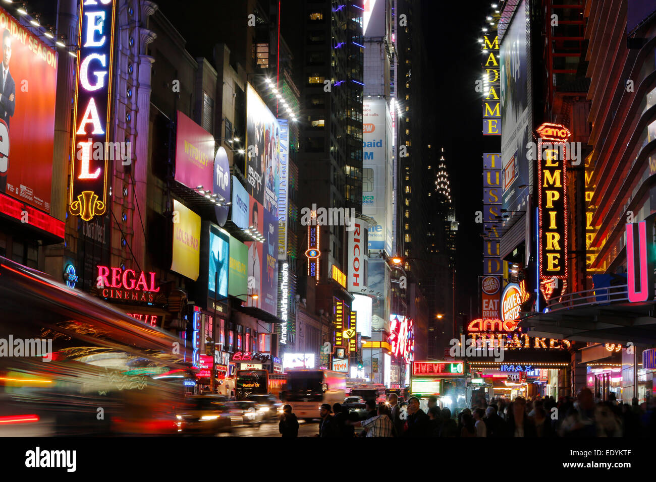 Neon signs of W 42nd Street, Chrysler Building at the back, New York City, New York, United States - Stock Image