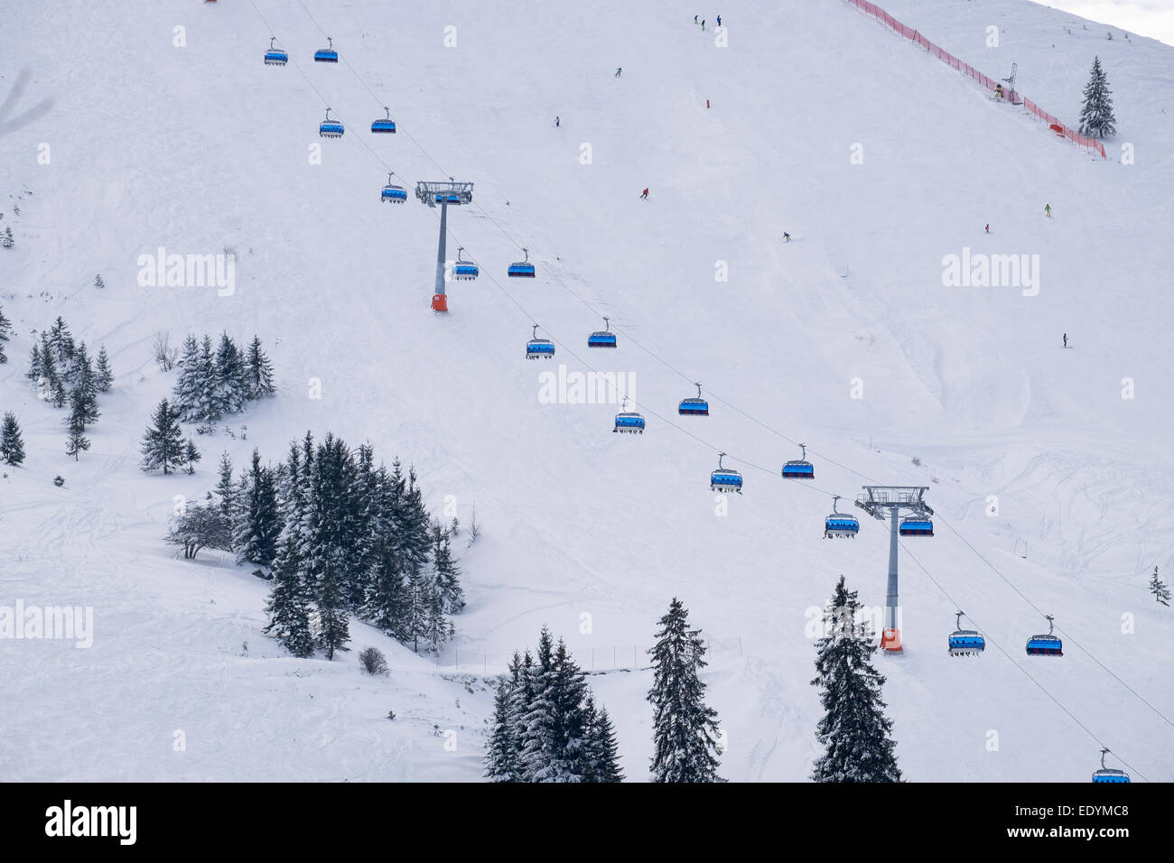 Six-seater chairlift in the Sudelfeld skiing area, Mangfall Mountains, Upper Bavaria, Bavaria, Germany - Stock Image
