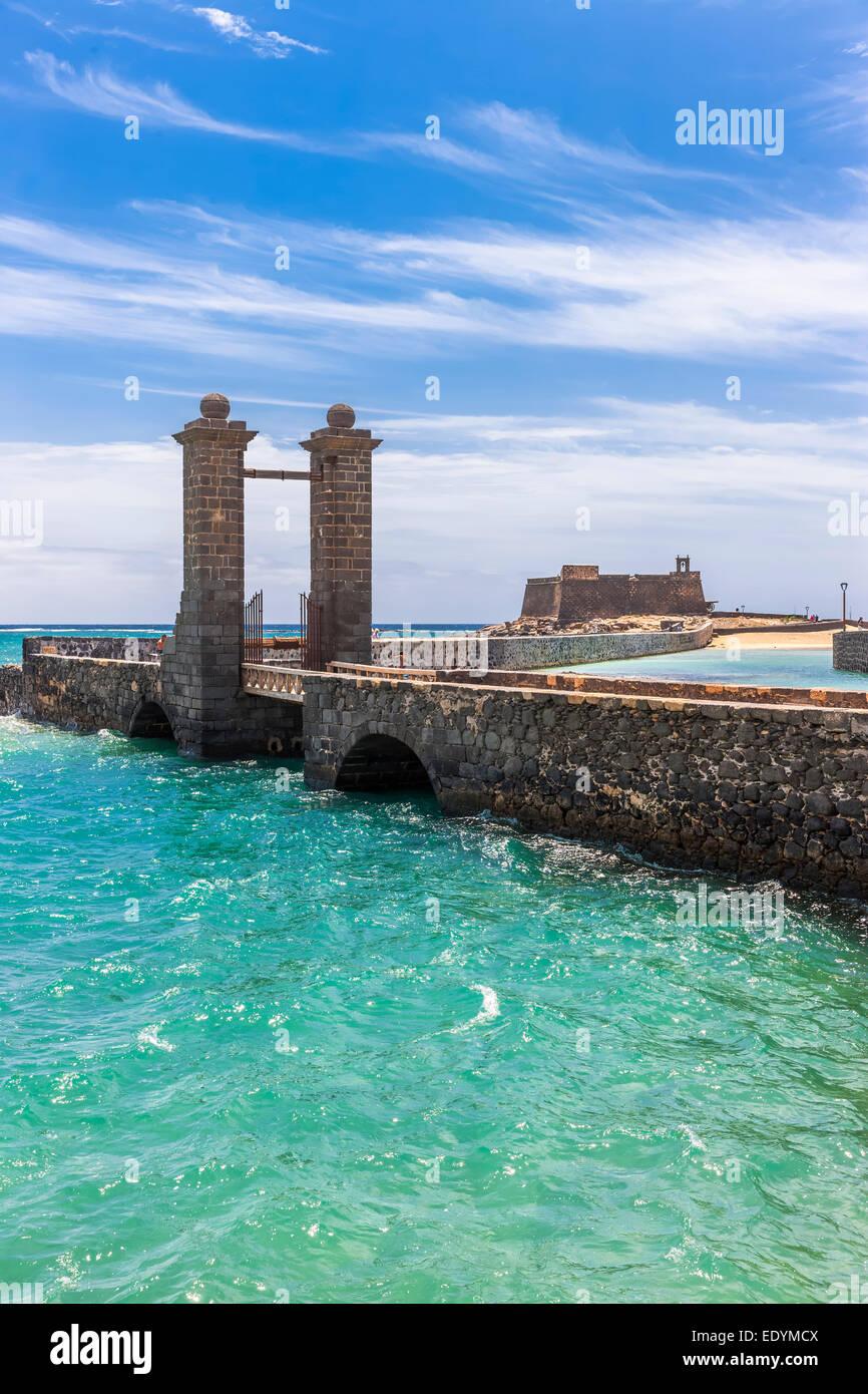 Bridge Puente de las Bolas, stone gate in front of the fort Castillo de San Gabriel, Arrecife, Lanzarote, Canary Stock Photo