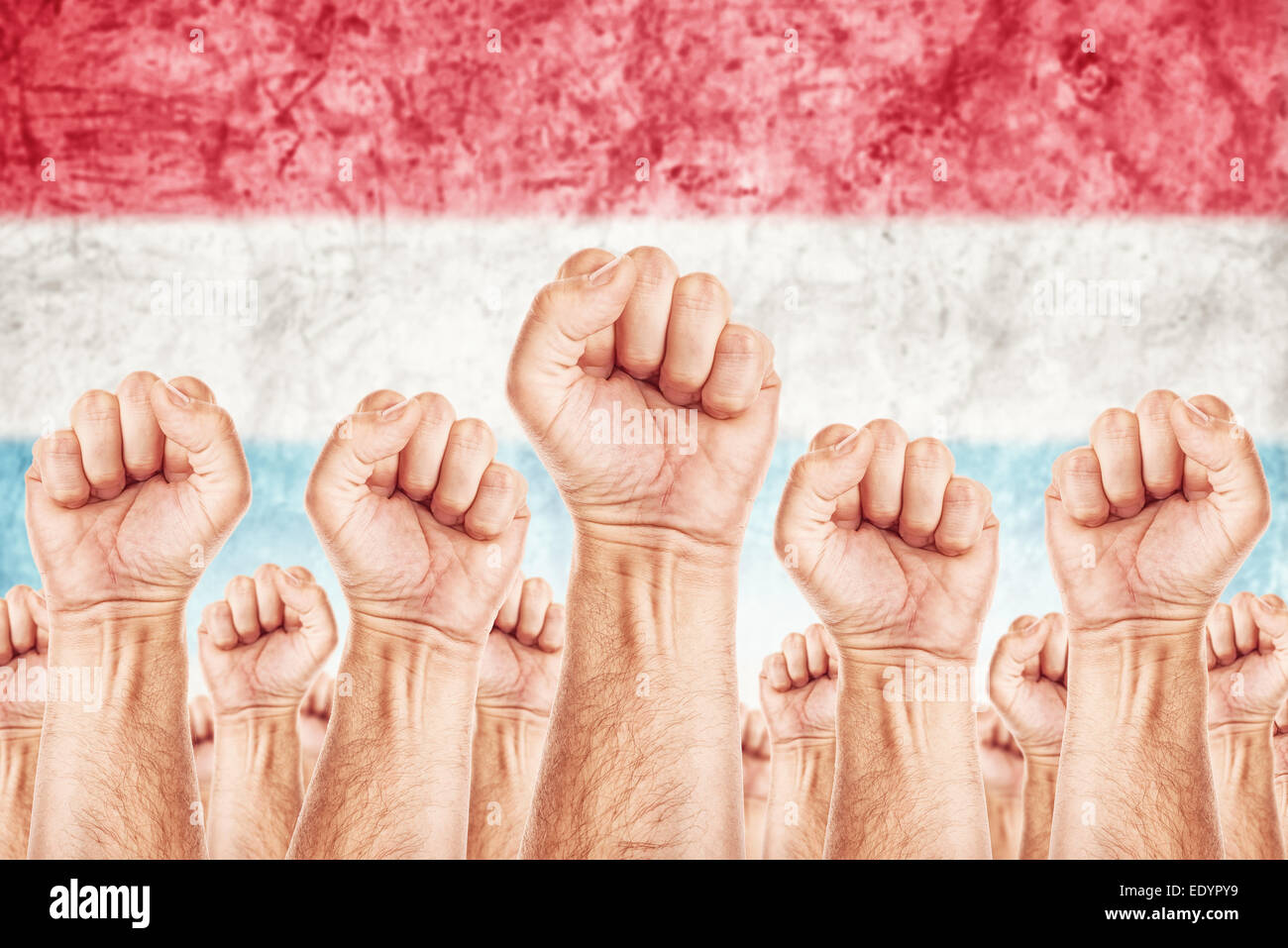 Netherlands Labor movement, workers union strike concept with male fists raised in the air fighting for their rights Stock Photo