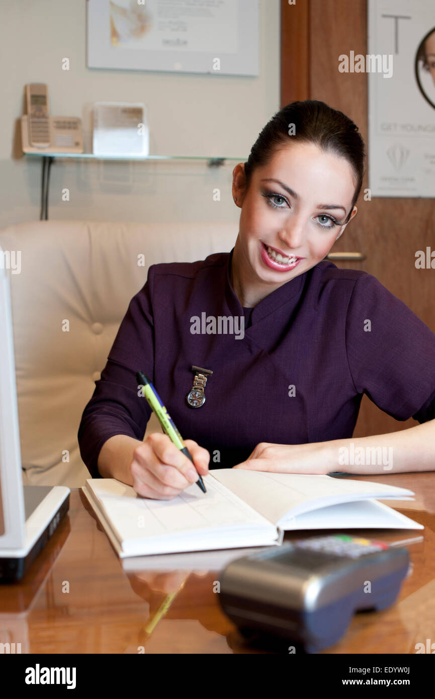 beautician working taking booking salon. credit: LEE RAMSDEN / ALAMY - Stock Image