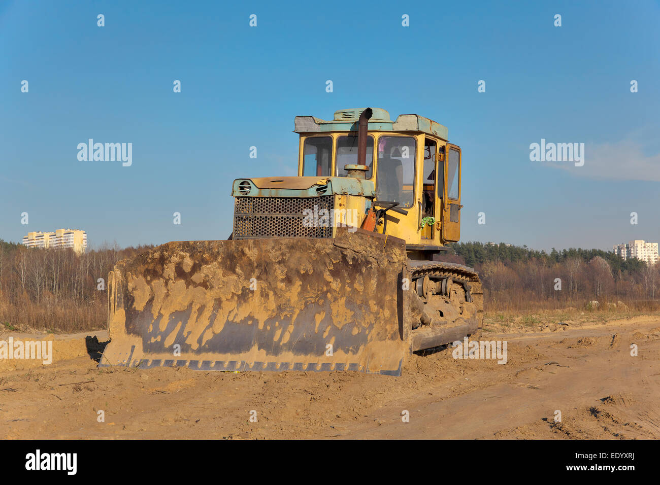 Yellow bulldozer on the construction site - Stock Image