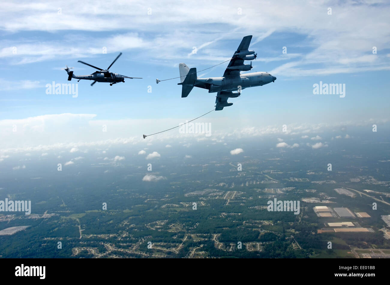 High altitude helicopter refueling operation from a C-130 Hercules tanker - Stock Image