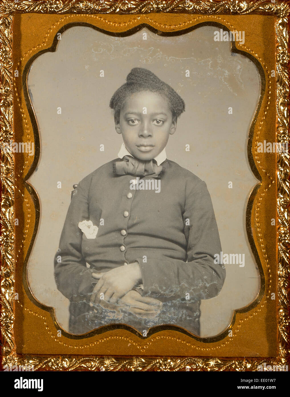 [Portrait of a Seated Black Child with Hands Crossed]; Unknown maker, American; about 1857 - 1858; Daguerreotype, - Stock Image