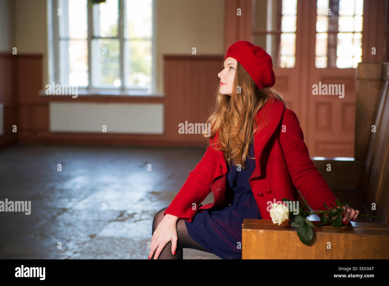 Woman at local train station is waiting guests - Stock Image