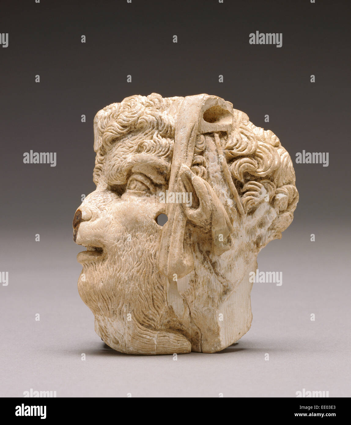 Applique depicting the head of pan; Unknown; East Greece; about 100 B.C.; Ivory - Stock Image